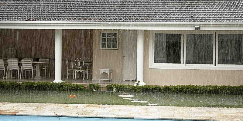 Houston houses with rain storm on roof.