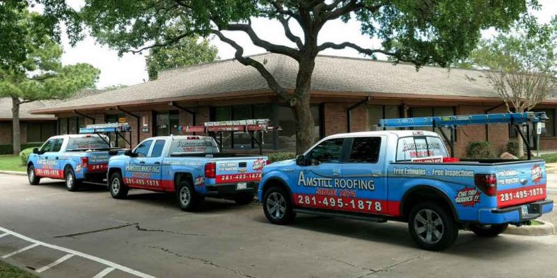 Amstill Roofing trucks working on Houston home.