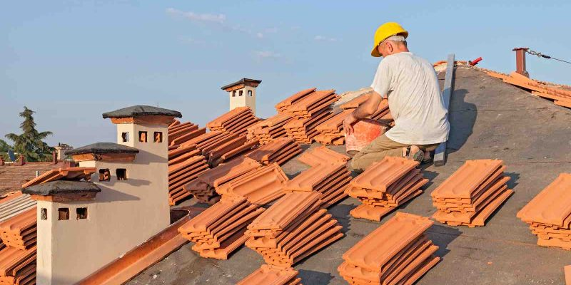 Roofing professional for Houston roofing company. Clay tile shingles.