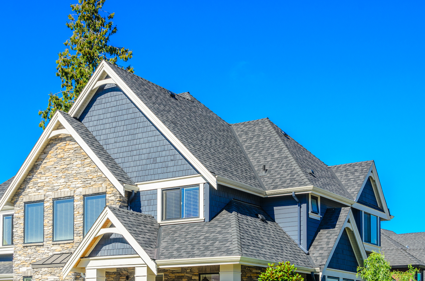 View of Friendswood roof replacement featuring architectural shingles