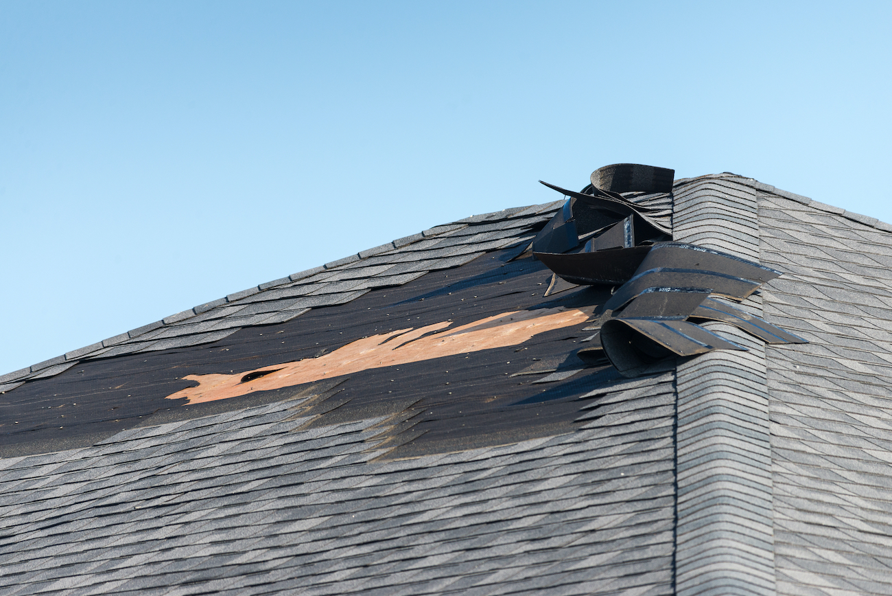 pearland roof exhibiting signs of severe wind damage from houston storms