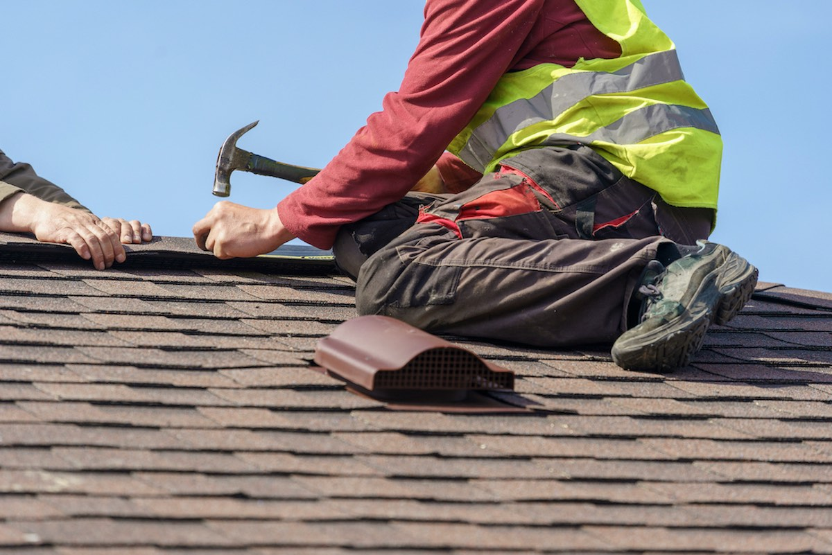 Team of Houston roofing contractors completing affordable Sugar Land roof repairs